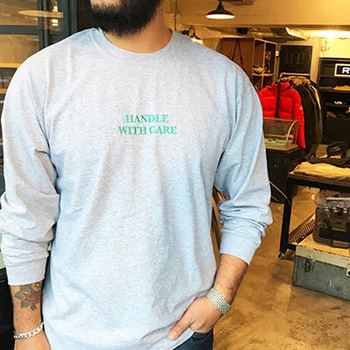 CAPTAINS HELM Delivery – #HANDLE WITH CARE L/S TEE